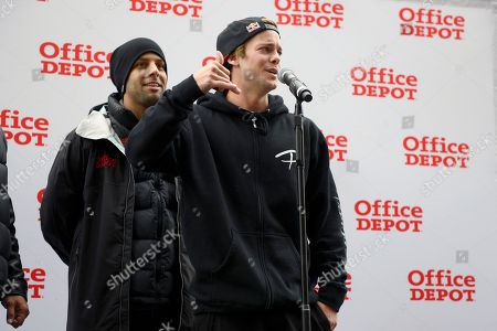 Ryan Sheckler addresses the crowd gathered before signing autographs for fans at the Office Depot ESPN X Games Preview as Keir Dillon looks,, in Denver. The preview celebrates the opening of several entirely new Office Depot stores in Denver