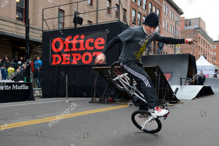 Pete Brandt, of San Francisco, performs on his BMX bike for fans at the Office Depot ESPN X Games Preview in Denver on . Skateboard star Ryan Sheckler signed autographs for fans at the preview celebrating the opening of several entirely new Office Depot stores in Denver