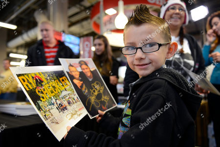 Destin McBride, 7 of Platteville, Colo., holds photos Ryan Sheckler autographed for him and other fans at the Office Depot ESPN X Games Preview in Denver on . The preview celebrates the opening of several entirely new Office Depot stores in Denver