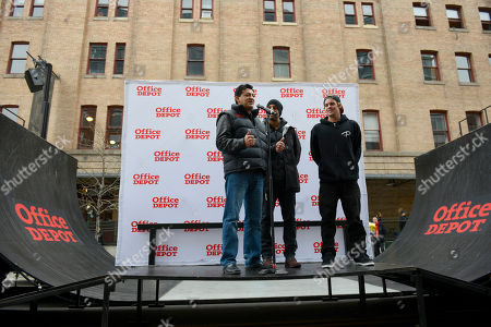 Juan Guerrero, Senior VP of Sales for Office Depot, addresses the crowd gathered as Keir Dillon, middle, and Ryan Sheckler stand by at the Office Depot ESPN X Games Preview in Denver on . The preview celebrates the opening of several entirely new Office Depot stores in Denver