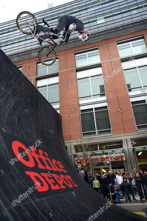 John Parker, of Arizona, performs on his BMX bike for fans at the Office Depot ESPN X Games Preview, in Denver. Skateboard star Ryan Sheckler signed autographs for fans at the preview celebrating the opening of several entirely new Office Depot stores in Denver