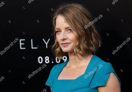 "Jodie Foster arrives at the world premiere of ""Elysium"" at the Regency Village Theater, in Los Angeles. A representative for the Oscar-winning actress confirms that Foster wed girlfriend Alexandra Hedison over the weekend. Publicist Jennifer Allen offered no other details"