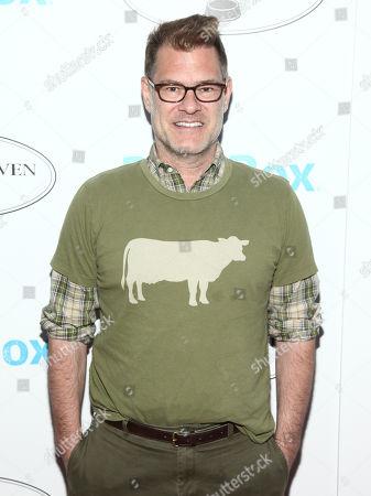"""John Bartlett attends the """"Pet Me"""" animal shelter opening celebration, in New York"""