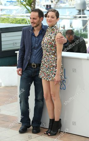 Actors Fabrizio Rongione and Marion Cotillard during a photo call for Two Days, One Night (Deux jours, une nuit) at the 67th international film festival, Cannes, southern France