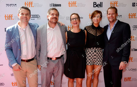 """Stock Image of Liza Johnson, center, director of """"Hateship Loveship,"""" poses with, left to right, co-screenwriter Mark Poirier, producer Jamin O'Brien, cast member Kristen Wiig and producer Rob Barnum at the premiere of the film on day 2 of the 2013 Toronto International Film Festival at The Princess of Wales Theatre on in Toronto"""