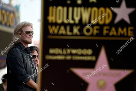 Pop music duo Darryl Hall, left, and John Oates look on before a ceremony to award them a star on the Hollywood Walk of Fame, in Los Angeles