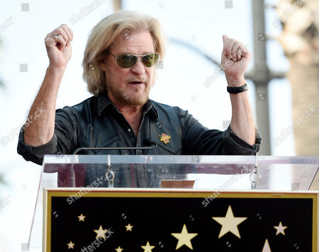 Daryl Hall addresses the crowd during a ceremony to award Hall and his musical partner John Oates a star on the Hollywood Walk of Fame, in Los Angeles