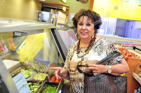 On, Debbie Phelps takes a break from a celebratory schedule to check out a familiar lunch spot while traveling abroad, visiting a local SUBWAY restaurant to eat a healthy meal on the go