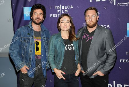 """Executive producer Olivia Wilde, center, poses with co-directors Bryn Mooser, left, and David Darg at the """"Character Witness: The Rider and the Storm"""" screening, in New York"""