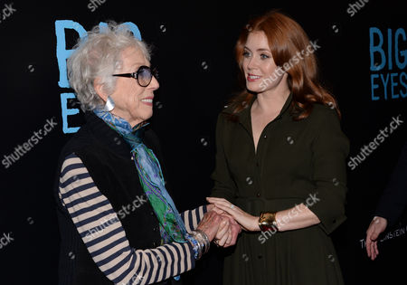 """Stock Image of Margaret Keane, left, greets actress Amy Adams at the """"Big Eyes"""" premiere at the Museum of Modern Art in New York. The movie releases in the U.S. on Chrismas Day, Dec. 25, 2014"""