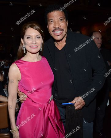 "Jean Shafiroff and Lionel Richie pose at private LA dinner for ""Song One"" screening hosted by Jean Shafiroff with director Kate Barker-Froyland and Anne Hathaway at The Palm Restaurant, in Beverly Hills, California"