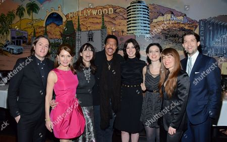 "From left, Jonathan Rice, Jean Shafiroff, Illeana Douglas, Lionel Richie, Anne Hathaway, Kate Barker-Froyland, Jenny Lewis and Thomas Froyland pose at private LA dinner for ""Song One"" screening hosted by Jean Shafiroff with director Kate Barker-Froyland and Anne Hathaway at The Palm Restaurant, in Beverly Hills, California"