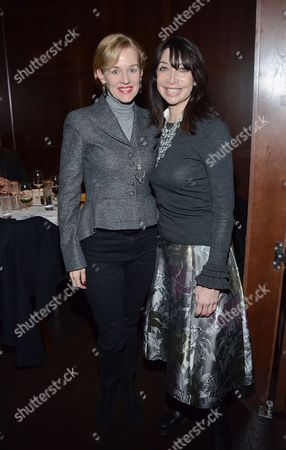 "Penelope Anne Miller, left, and Illeana Douglas pose at private LA dinner for ""Song One"" screening hosted by Jean Shafiroff with director Kate Barker-Froyland and Anne Hathaway at The Palm Restaurant, in Beverly Hills, California"