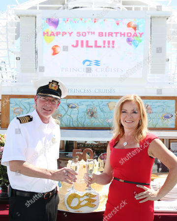 Princess Cruises' Celebrations Ambassador and actress Jill Whelan, right, celebrates her 50th birthday with Captain Nick Nash aboard Ruby Princess on in Los Angeles