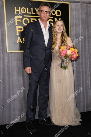 President of the Hollywood Foreign Press Association Theo Kingma, left, and Greer Grammer attend the press conference where she was named Miss Golden Globe 2015, in West Hollywood, Calif