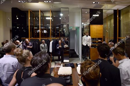 Todd Hoyles, Vice President / General Manager, Saks Fifth Avenue, left, and stylist Jeanne Yang speak at the Saks' Men's Formal Wear Shop Opening, in Beverly Hills, Calif