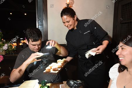 Celebrity Chef Antonia Lofaso serves a handcrafted dish featuring California Olive Ranch extra virgin olive oil at Sip & Dip: The Culture of California Olive Oil at her restaurant Scopa, in Venice, Calif