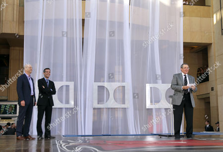 From left, Kevin Yeaman, president and CEO of Dolby Laboratories, Ramzi Haidamus, EVP, sales and marketing, Dolby Laboratories and Tom Sherak, president of the Academy of Motion Picture Arts and Sciences unveil the new Dolby Theatre on in Los Angeles