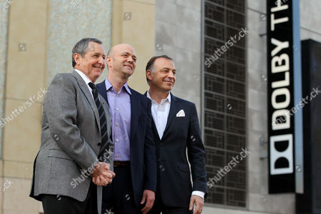 From left, Tom Sherak, president of Academy of Motion Picture Arts and Sciences, Kevin Yeaman, president and CEO of Dolby Laboratories and Ramzi Haidamus, EVP, sales and marketing, Dolby Laboratories, unveil the new Dolby Theatre on in Los Angeles