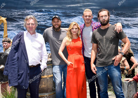 """Stock Photo of IMAGE DISTRIBUTED FOR THE HISTORY CHANNEL - HISTORY's VIKINGS series creator and writer Michael Hirst, left, poses with VIKINGS stars Travis Fimmel, Katheryn Winnick, Alexander Ludwig, and Clive Standen at the """"On the Set with VIKINGS"""" interactive experience outside the 2014 Comic-Con International Convention on in San Diego. Throughout the weekend, fans got a behind-the-scenes look at VIKINGS and a starring role in their own custom video"""