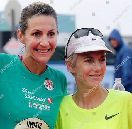 Summer Sanders, left, Olympic Gold Medalist and Team Safeway runner, with fellow Olympian Joan Benoit Samuelson, right, at the Nike Women's Marathon finish line in San Francisco on . Sponsored by Safeway, the Nike Women's Marathon is the largest women's marathon in the world with 25,000 runners