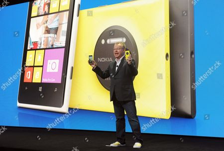 IMAGE DISTRIBUTED FOR NOKIA -Nokia president and CEO Stephen Elop unveils the new Nokia Lumia 1020 smartphone, with a 41-megapixel camera, during a press event in New York, . The Nokia Lumia 1020 reinvents zoom with a high resolution camera featuring Zeiss optics, six lenses, optical image stabilization and allows for clear pictures in low light conditions