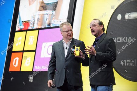 IMAGE DISTRIBUTED FOR NOKIA - Nokia president and CEO Stephen Elop, left, and AT&T Mobility president and CEO Ralph de la Vega announce that AT&T will be the exclusive U.S. service provider for the Nokia Lumia 1020 during the unveil of the new smartphone in New York, . The Nokia Lumia 1020 reinvents zoom with a high resolution camera featuring Zeiss optics, six lenses, optical image stabilization and allows for clear pictures in low light conditions
