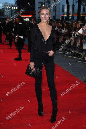 Kimberly Garner poses for photographers upon arrival at the premiere of the film 'Deepwater Horizon' in London