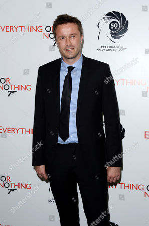 """Stevan Riley poses at the screening for the documentary film, """"Everything or Nothing - The Untold Story of 007,"""" at Odeon West End in London. Riley's film, """"Listen to Me Marlon,"""" is included in the World Documentary Competition, at the 2015 Sundance Film Festival, in Park City, Utah. The festival runs Jan. 22 through Feb. 1, 2015"""