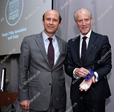 Stock Picture of President and CEO, Foreign Policy Association Noel V. Lateef, left, and MoMA Director Glenn D. Lowry are seen at the The Foreign Policy Association's Spring Dinner at the St. Regis, where the the Museum of Modern Art received The Foreign Policy Association Medal on in New York