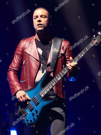 Christopher Wolstenholme of the English rock band Muse performs in concert during the bands The 2nd Law Tour at the Wells Fargo Center, in Philadelphia