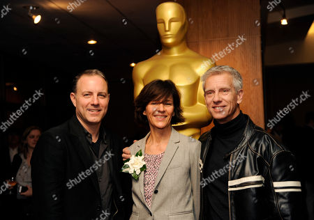 "Kirk DeMicco, left, and Chris Sanders, right, co-directors of the Oscar-nominated animated feature film ""The Croods,"" pose with producer Kristine Belson at a reception featuring the Oscar nominees in the Animated Feature Film category, in Beverly Hills, Calif. The 86th Oscars ceremony will be held on Sunday at the Dolby Theatre in Los Angeles"
