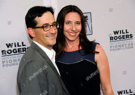 Barbara Neinstein, daughter of honoree Tom Sherak, poses with her husband Paul Neinstein at the Pioneer of the Year dinner on the third day of CinemaCon 2014 on in Las Vegas