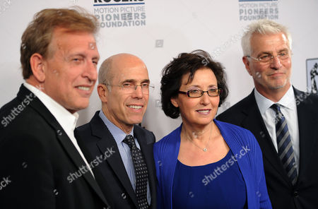 Stock Picture of Madeline Sherak, widow of honoree Tom Sherak, poses with, from left, producer Joe Roth, Dreamworks Animation CEO Jeffrey Katzenberg and Lionsgate Films Chairman Rob Friedman at the Pioneer of the Year dinner on the third day of CinemaCon 2014 on in Las Vegas