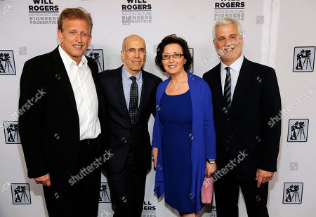 Stock Photo of Madeline Sherak, widow of honoree Tom Sherak, poses with, from left, producer Joe Roth, Dreamworks Animation CEO Jeffrey Katzenberg and Lionsgate Films Chairman Rob Friedman at the Pioneer of the Year dinner on the third day of CinemaCon 2014 on in Las Vegas