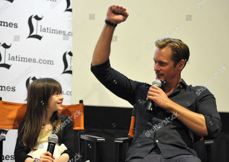 """Onata Aprile, left, and Alexander Skarsgard appear on stage during the Q&A for the LA Times Screening of """"What Maisie Knew"""" on in North Hollywood, Calif"""