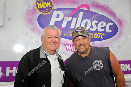 Bobby Allison, left, and Larry the Cable Guy are seen at the new Prilosec OTC Wildberry 'Wild American Flavor Tour' at the Talladega Superspeedway NASCAR race, on in Talladega, Ala