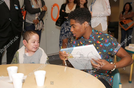 Nadji Jeter (right) and a patient attend Starlight Children's Foundation's Fun Center dedication at Children's Hospital Los Angeles, in Los Angeles