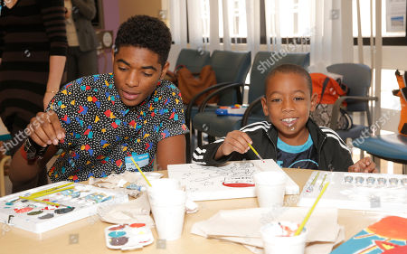 Nadji Jeter and a patient attend Starlight Children's Foundation's Fun Center dedication at Children's Hospital Los Angeles, in Los Angeles