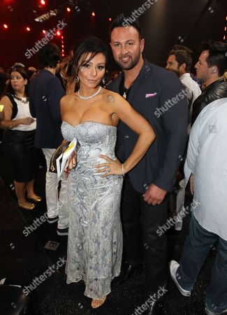 """Roger Matthews, right, and Jenni """"JWOWW"""" Farley at the MTV Movie Awards in Sony Pictures Studio Lot in Culver City, Calif., on"""