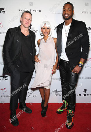 Stock Picture of Designer Alejandro Ingelmo, stylist Calyann Barnett and Dwyane Wade arrive during the Wade, Li-Ning & Alejandro Ingelmo shoe design unveiling at the Ritz-Carlton Residences, Miami Beach on in Miami Beach, FL