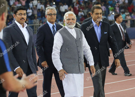 Indian Prime Minister Narendra Modi (front), Indian Sports minister Rajyavardhan Rathore(L), President of the All India Football Federation Praful Patel (R), Asian Football Confederation President Sheikh Salman Bin Ibrahim Al-Khalifa (back) arrive before the FIFA Under-17 World Cup 2017 group A soccer match between India and USA at the Jawaharlal Nehru Stadium in New Delhi, India, 06 October 2017.