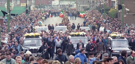 Mourners including Martin McGuinness, walk during the funeral for Sean Savage, Daniel McCann and Mairead Farrell who were killed in Gibralter 10 days previously, in Belfast on March 16, 1988.