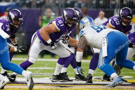 Minnesota Vikings offensive guard Joe Berger (61) looks to make a block during the first half of an NFL football game against the Detroit Lions, in Minneapolis