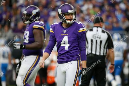 Minnesota Vikings punter Ryan Quigley walks off the field during the second half of an NFL football game against the Detroit Lions, in Minneapolis
