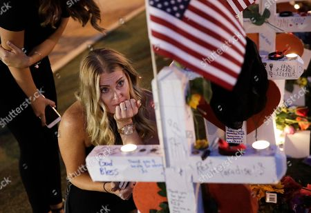 Jamie Lambert visits a makeshift memorial, for victims of a mass shooting in Las Vegas. Stephen Paddock opened fire on an outdoor music concert on Sunday killing dozens and injuring hundreds