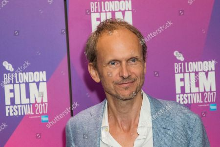 Director Julian Rosefeldt poses for photographers upon arrival at the London Film Festival Connect event in London
