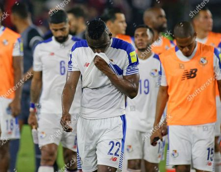 Panama's Abdiel Arroyo (22) walks off the field with teammates after their 4-0 loss to the United States in a World Cup qualifying soccer match, in Orlando, Fla