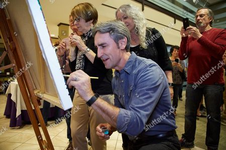 Stock Photo of Mike Wolfe, participating in the paint by number Debbie Smartt photograph of the Dr. McPhail building at an event for Partners in Preservation: Main Streets, a campaign from American Express, the National Trust for Historic Preservation and Main Street America, on October 6th, 2017 in Franklin, TN