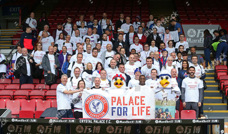 Crystal Palace fans are joined by former crystal palace players Andrew Johnson and Andy Gray and Julian Speroni of Crystal Palace along with Crystal Palace mascots Pete and Alice the eagle ahead of the Palace For Life Marathon March powered by Utilita, 7th October 2017 at Selhurst Park Stadium, Croydon, London.